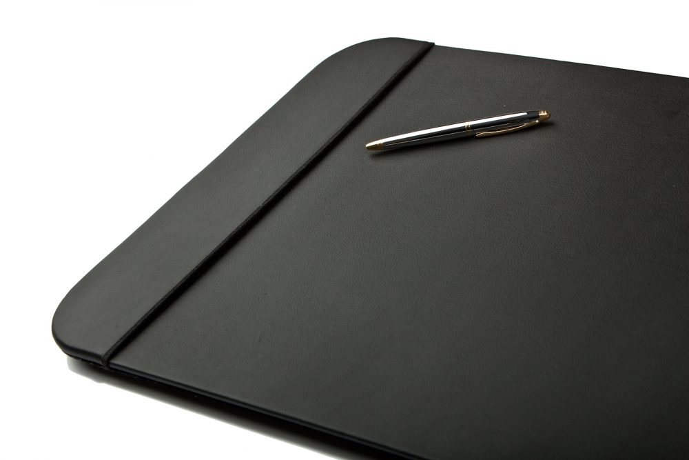 Slick Picture of desk pad with a pen black
