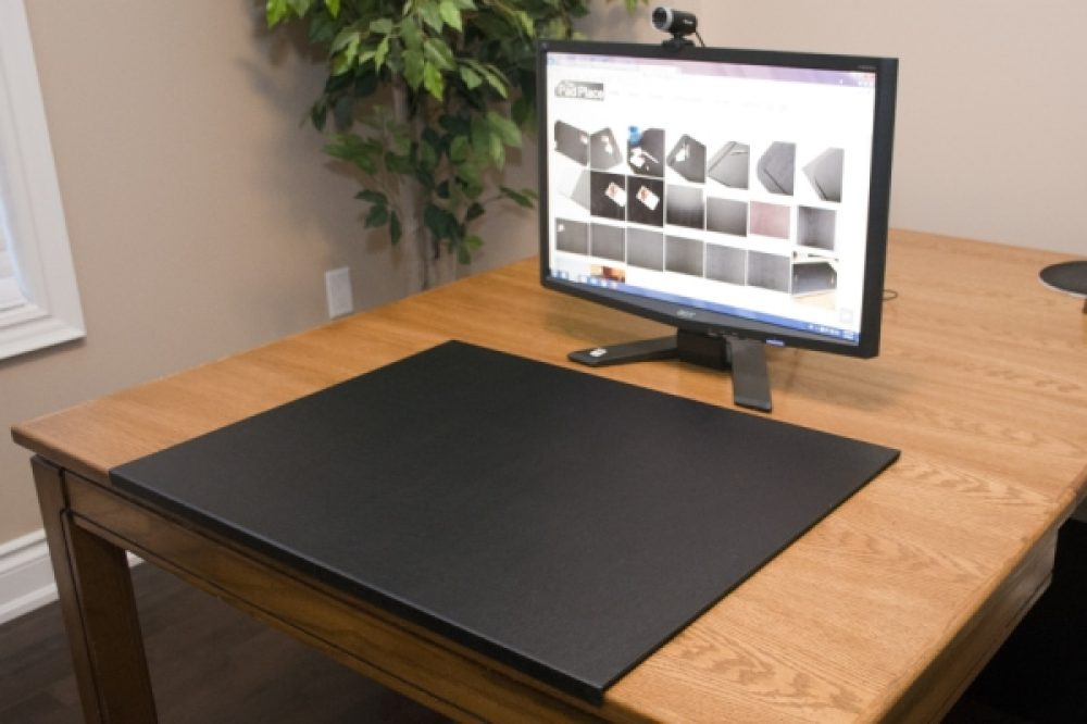 Desk protector on maple desk with monitor
