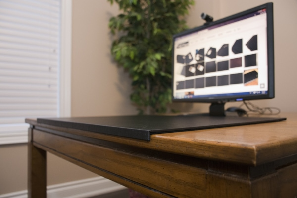 Angle shot of desk mat with edge protection black