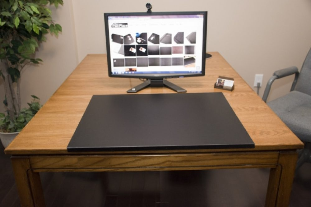 Desk pad with edge protector